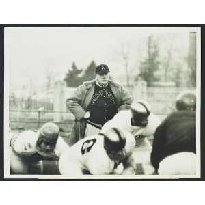 Football coach Earl Red Blaik,West Point jacket,players