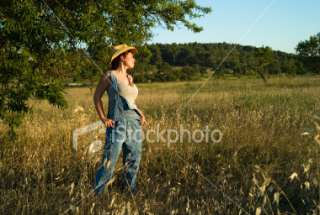 FARMER GIRL ON SUNSET Royalty Free Stock Photo